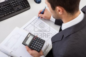 14929635-successful-accountant-working-with-financial-data-in-the-office